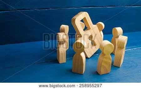 Bank Secrecy, Medical Secret. Wooden Figures Of People Stand Around A Padlock On A Blue Background.