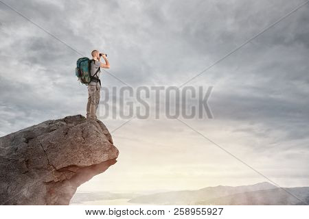 Explorer On The Peak Of A Mountain