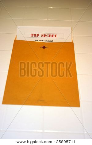 A Top Secret (for your eyes only) document peeks out of a manila envelope