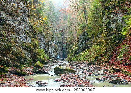 Waterfall With Water Falling From Cliff. Manyavskii Waterfall In Carpathian Mountains. Water Falling