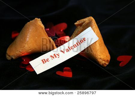 Be my Valentine Fortune cookie on blue velvet with metalic red hearts