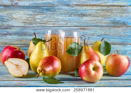 Fresh Organic Farm Pear-apple Juice In Glass With Raw Whole Sliced Pears And Apples On Woody Backgro