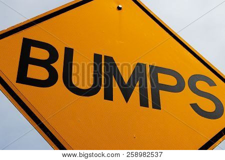 Abstract Bumps Road Sign Close Up And A Blue Sky