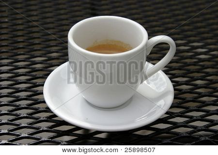 expresso on a mesh table outside