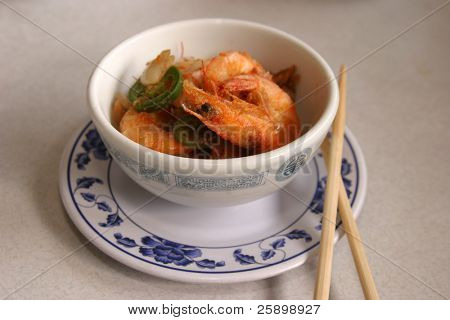 crispy whole shrimp with chops sticks in a chinese resturant