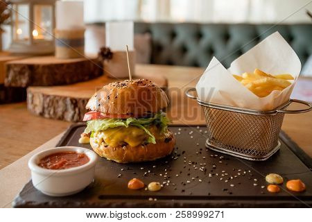 Fast Food. Hamburger. Close-up Fresh Delicious Tasty Homemade Burger. This Hamburger With French Fri