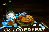 October fest concept. Wooden table in pub pint glass cup of beer with blue tape, snacks, chips, sweet pritzels and smoked sasuges. Ready for october beer festival in autumn october month in germany poster