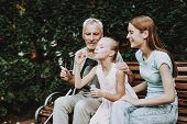 Man Stroller with Good Family. Businessman Play with Girl. Medicine Help Old Man with Health. Mature Man and Young Girl Play. All Family sit on Bench in Nature. Happy time with all Family. Care Family poster