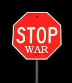 A stop war sign on a metal post over black background. poster