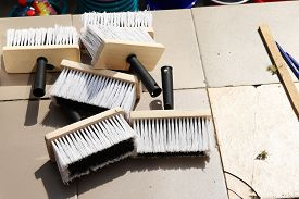 A Large Brush For Coloring In The Assortment, The Brush For Whitewashing The Trees Are Prepared For