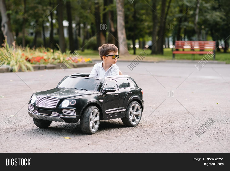 Cute Boy Riding Black Image Photo Free Trial Bigstock