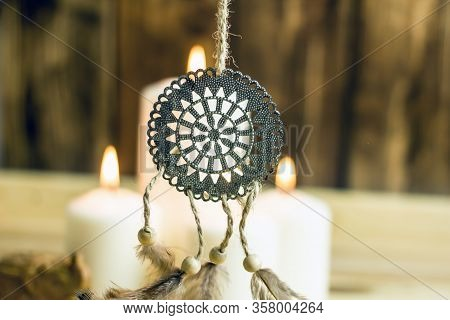 Dreamcatcher Amulet Feng Shui. Dream Catcher From Metal And Farts Against The Background Of Burning