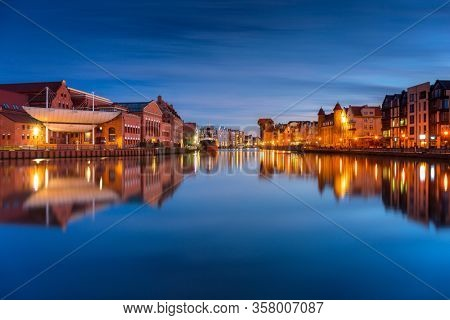 Gdansk with beautiful old town over Motlawa river at dusk, Poland.