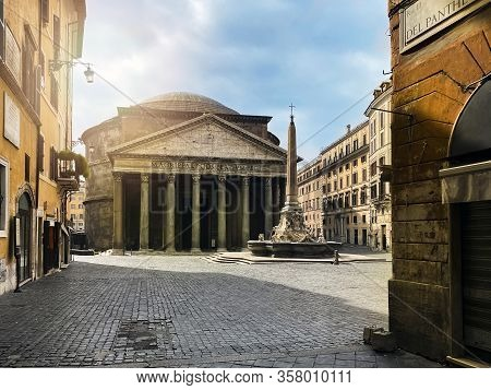 The Pantheon And The Fountain In Piazza Della Rotonda In Rome Seen From Via Del Pantheon. Italy Famo