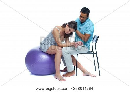 A Young Black Man Helps His White Wife With Birth Pain With A Ball. Partnered Birth, Partnered Deliv