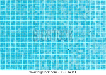 Background Of Blue Small Tiles At A Swimming Pool As Harmonic Background