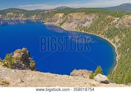 Blue Waters In A Volcanic Crater On Crater Lake In Crater Lake National Park In Oregon