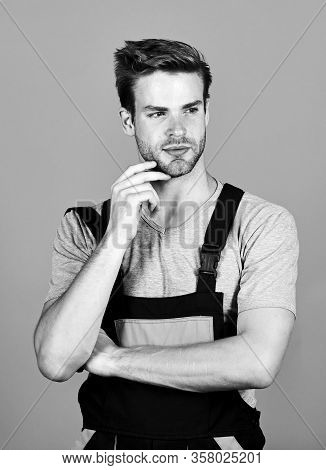Assemble And Set Up Machinery Or Equipment. Thoughtful Repairman. Handsome Repairman. Worker Violet