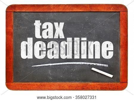 tax deadline white chalk text on a vintage slate blackboard, extended deadline for 2020 due to coronavirus pandemic