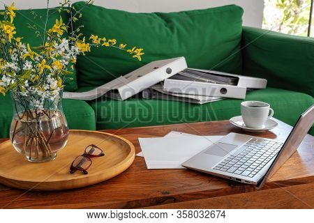 Home Office In The Living Room, Laptop On The Coffee Table And Ring Binders On The Couch, Exceptiona