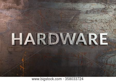 Word Hardware Laid In With Silver Metal Letters On Rusted Heavy Hot Rolled Uncoated Steel Sheet Surf