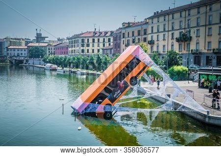 Milan, Italy, September 9, 2018: Bus Partially Immersed In Lake, Fell Into River And Kept On Web, Sp
