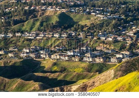 Rows of hilltop mountain view of homes in the San Fernando Valley area of north Los Angeles, California.