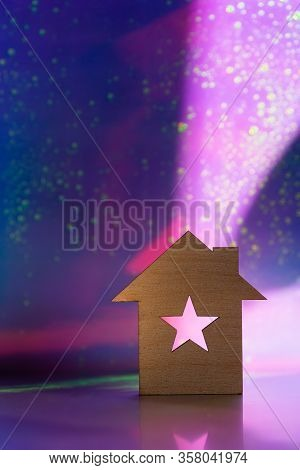 Wooden Icon Of House With Hole In The Form Of Star On Pink And Purple Dark Galactic Background With