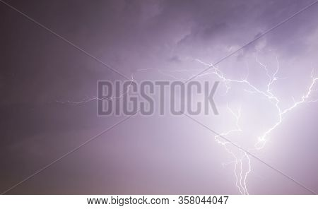Night Landscape With Black Sky Illuminated By Lightning Discharge During Thunderstorms, Real Windy A