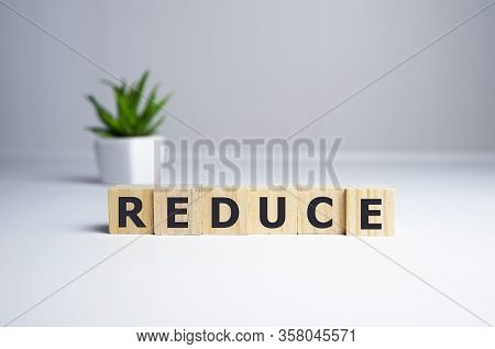 Reduce Word Written On Wood Block. Reduce, Reuse And Recycle Text On Wooden Table For Your Desing, C
