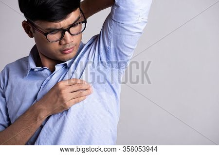 Close Up Asian Man With Hyperhidrosis Sweating. Young Asia Man With Sweat Stain On His Clothes Again