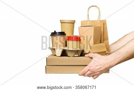 Male Hands Holding Various Take-out Food Containers, Pizza Box, Coffee Cups In Holder And Paper Bag