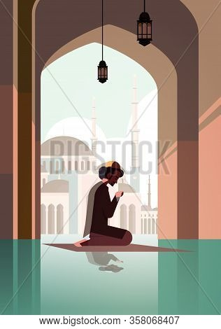 Religious Muslim Man Kneeling On Carpet And Praying Inside Mosque Ramadan Kareem Holy Month Religion