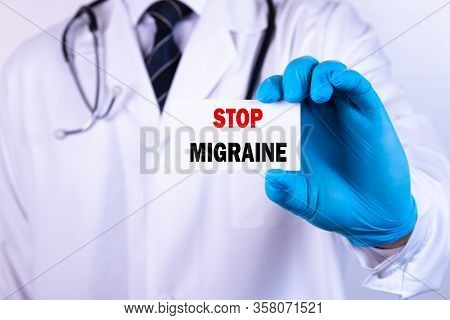 Doctor Holding A Card With Text Stop Migraine Medical Concept