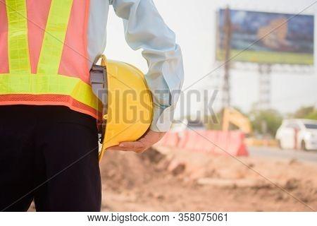 Supervisor Holding Hard Hat At Construction Site