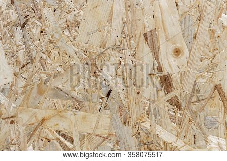 Wood Texture - Osb-board Background: Section Of An Oriented Strand Board, Made Of Different Kinds Of