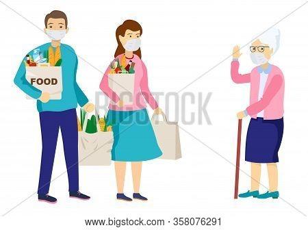 Medical Masked Volunteers Brought Food To An Elderly Woman. Volunteer Social Worker Delivers Grocery
