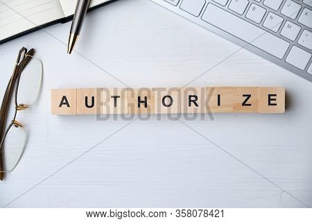 Modern Business Buzzword - Authorize. Top View On Wooden Table With Blocks. Top View. Close Up.