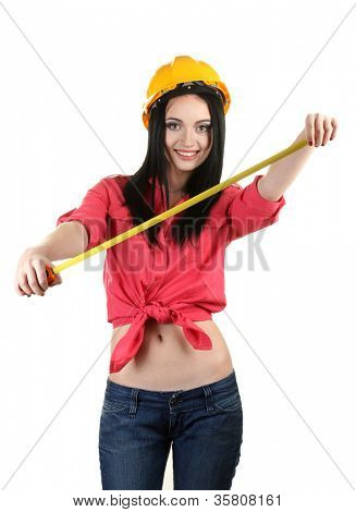 beautiful young girl-builder  holding building roulette isolated on white