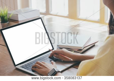 Cropping Hands Using Computer Laptop. Blank Screen Computer Laptop  For Graphic Display Montage.