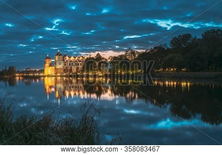 Mir, Belarus. Panorama Of Mir Castle Complex In Bright Evening Illumination With Glow Reflections On