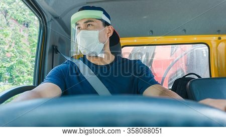 Close-up Photos Of Asian Truck Drivers Wearing Masks To Protect Against Dust And The Spread Of The F