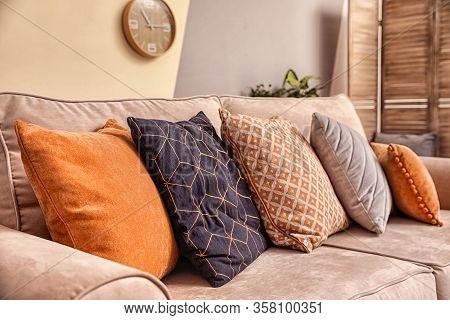 Cushions With Pattern, Grey And Orange On Sofa Indoors, Closeup