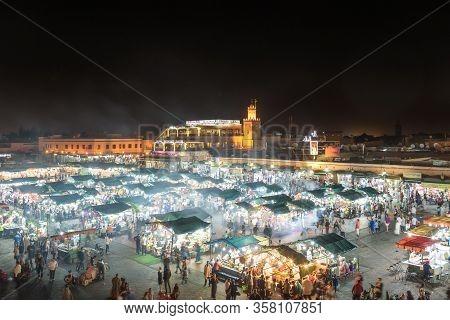 Marrakech, Morocco - December 28, 2018: People On Jamaa El Fna Market Square. Jemaa El-fnaa, Djema E