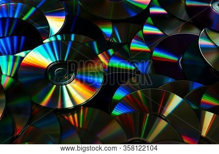 Group Of Old Cd Dvd Compact Optical Disk Storage Medium With Dust And Scratches. Rainbow Spectrum Of