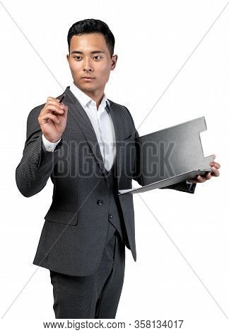 Isolated Half Length Portrait Of Serious Young Asian Businessman In Elegant Suit Holding Clipboard A