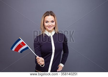 Immigration And The Study Of Foreign Languages, Concept. A Young Smiling Woman With A Costa Rica Fla
