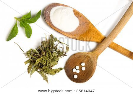 Stevia sweetener as powder dried and tablets isolated on white