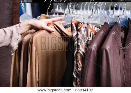 Choosing a piece of clothing, close up