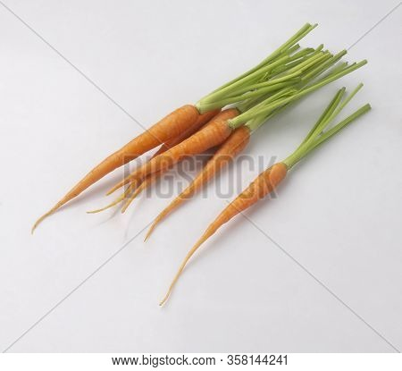 Bunch Of Baby Carrots Isolated On White Background